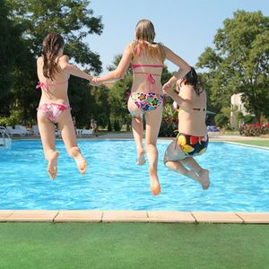 Teenagers jumping in pool