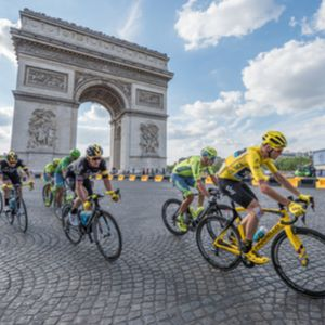 Chris Froome, wearing the leader's yellow jersey in front of Arc de Triomphe during the Tour de Fran